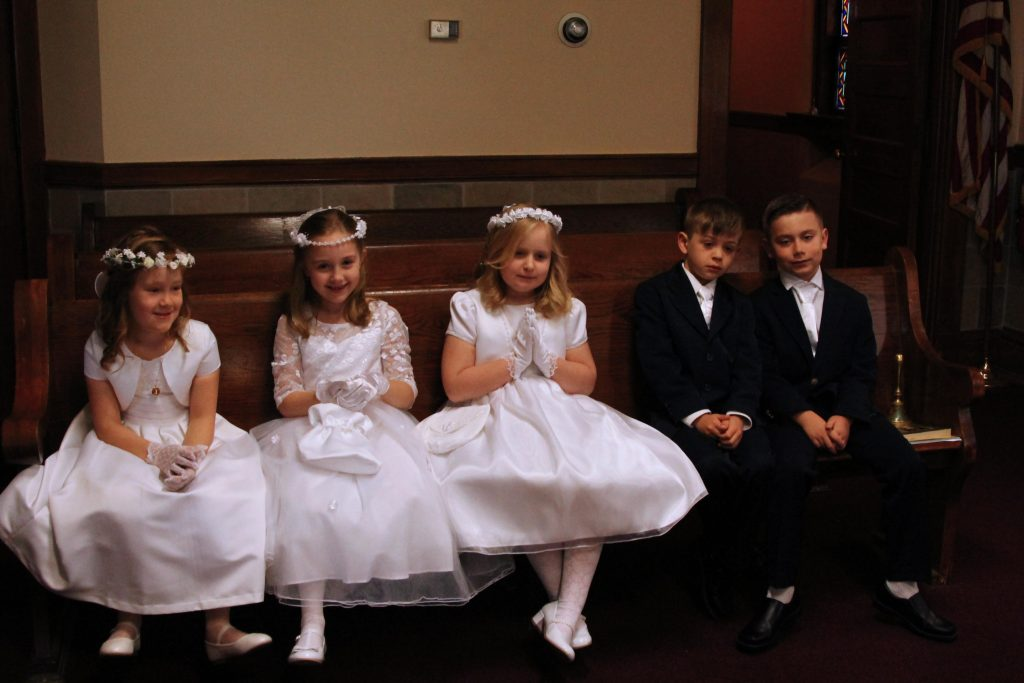 First Communion Children wait for start of Mass