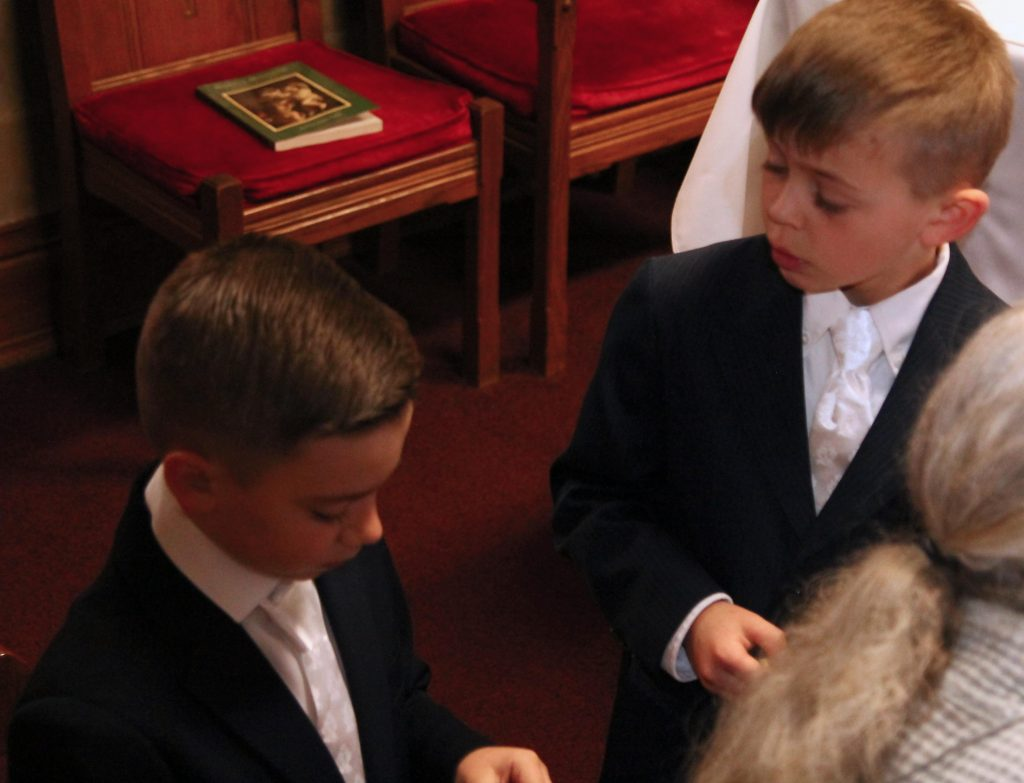 First Communion Boys wait in sacristy
