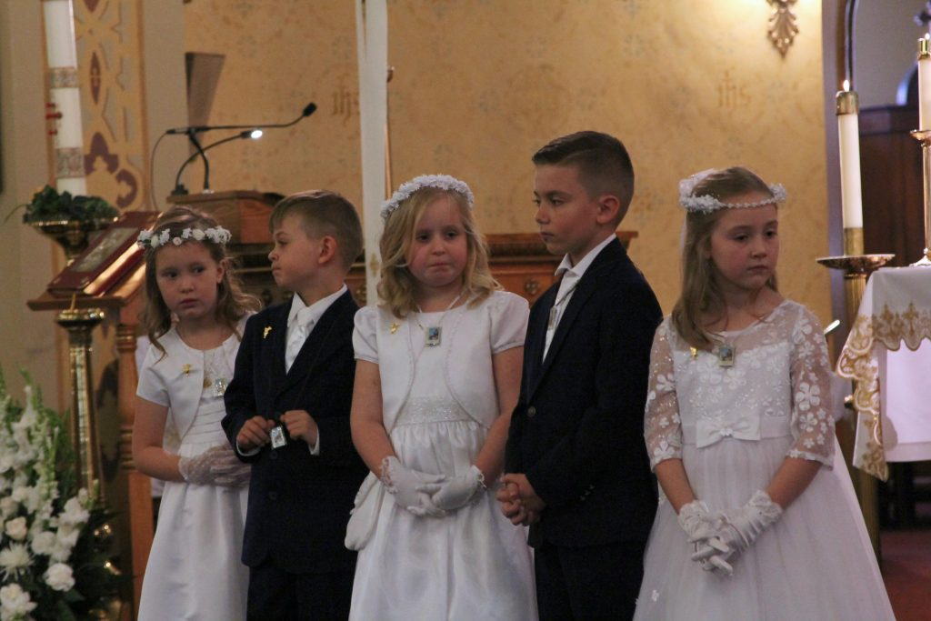 First Communion Children Face Congregation